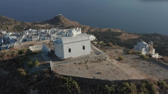 Thumbnail for Church on Top of the Hill with Greek Flag Waving in Wind Aerial Perspective