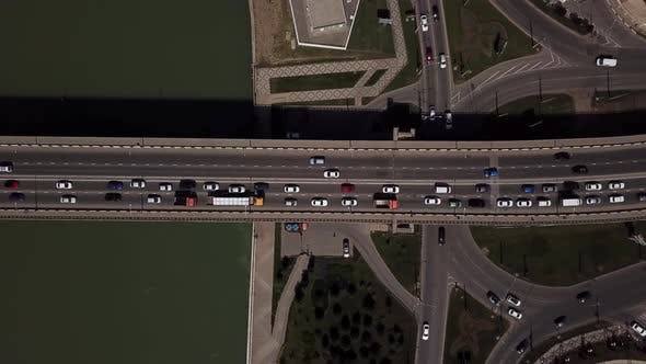 Thumbnail for Drone's Eye View -  Flight Over Slow Flow Of Cars In Traffic Jam On Highway