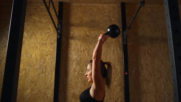 Thumbnail for Beautiful Athletic Girl Is Training in the Gym