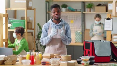 Cheerful Black Man Advertising Eco Food Delivery Service