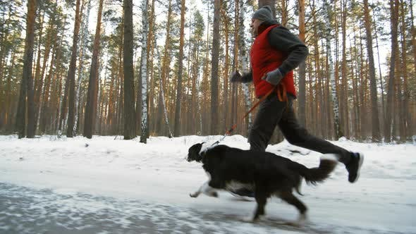 Thumbnail for Man and Dog Running Fast in Woods
