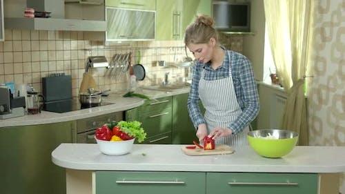 Woman Cutting Paprika