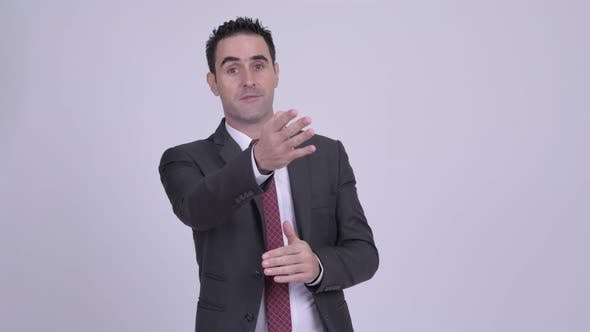 Thumbnail for Handsome Businessman Talking Against White Background