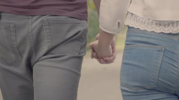 Thumbnail for Close Up Back Footage of Couple Holding Hands
