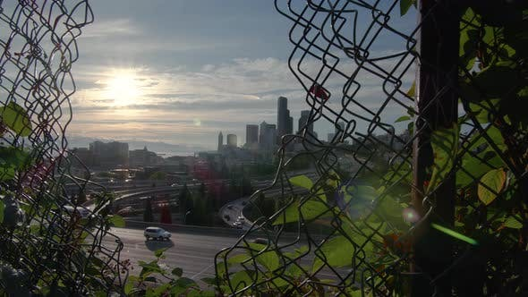 Thumbnail for Cinematic Cityscape Dolly Reveal Of Seattle Skyline With Sun Flare