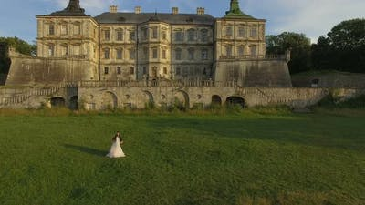 Aerial View of Wedding Couple Dancing at Ancient Castle