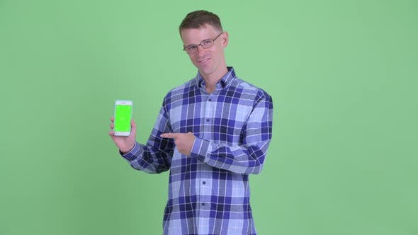Thumbnail for Portrait of Happy Hipster Man Showing Phone and Giving Thumbs Up