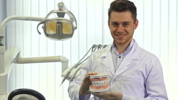 Thumbnail for Dentist Shows His Thumb Up at the Office