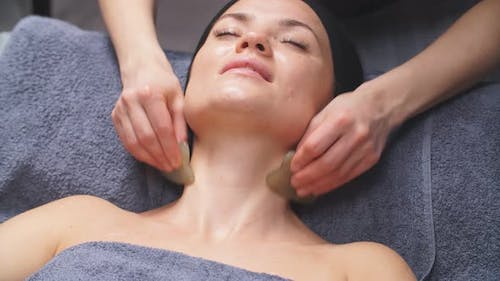 Caucasian Lady Gets a Facelift Massage at a Beauty Salon. the Concept of Facial Skin Care