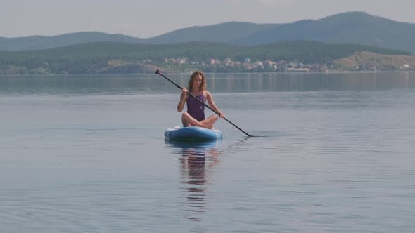 Sporty Woman Paddling in Water