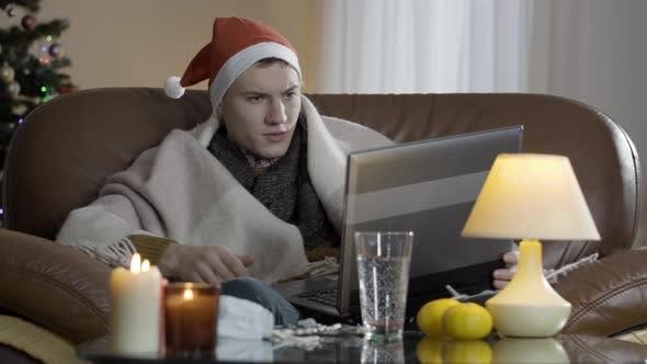 Thumbnail for Sad Ill Caucasian Man Consulting Doctor Online on Coronavirus Pandemic on Christmas Eve