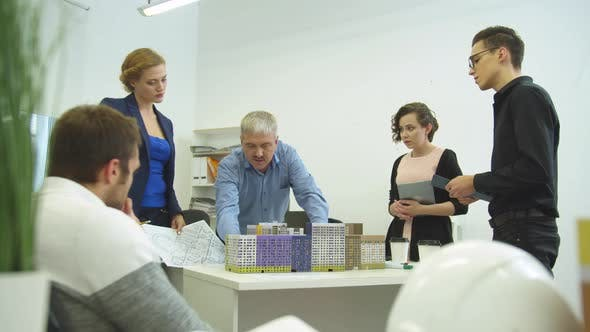 Thumbnail for Working Day, Engineers Discuss Project of Houses in the Office