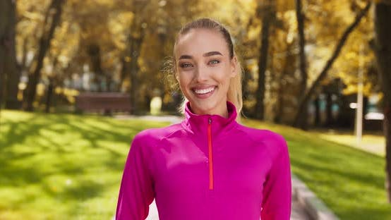 Thumbnail for Outdoor Portrait of Happy Sportive Woman Smiling To Camera in Autumn Park