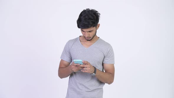 Thumbnail for Young Happy Bearded Indian Man Using Phone