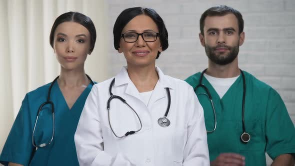 Medical Staff Smiling at Camera, Health Care System and Insurance Reform Policy