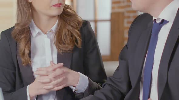 Thumbnail for Female and Male Business Partners Reaching Agreement at Negotiations, Handshake