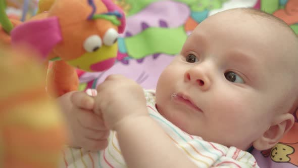 Thumbnail for Portrait of Little Child Looking Toys. Close Up of Cute Infant Boy