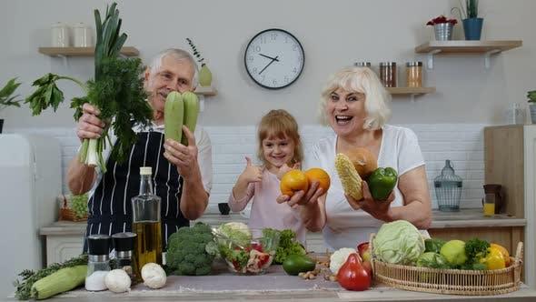 Thumbnail for Grandchild Girl with Senior Grandparents Recommending Eating Raw Vegetable Food. Nutrition Diet