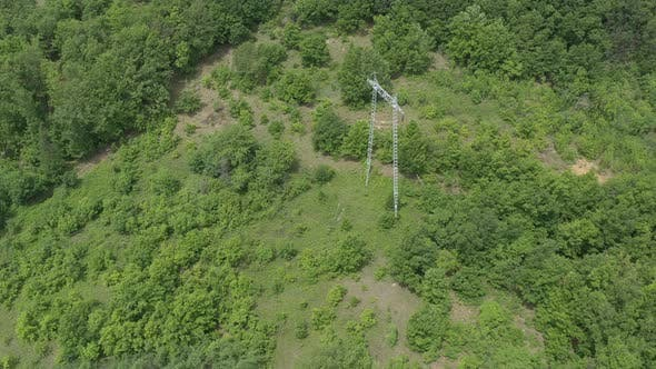 Thumbnail for Electric power pylon and transmission cables from above 4K aerial video