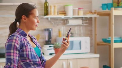 Lady Searching on Internet Using Smartphone