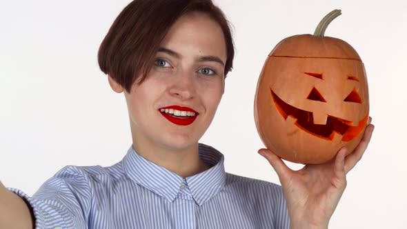 Thumbnail for Lovely Red Lipped Woman Taking Selfies with Carved Halloween Pumpkin