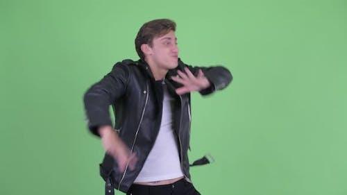 Happy Young Rebellious Man Dancing
