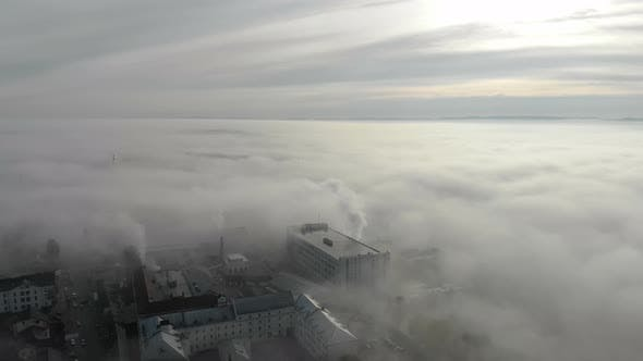 Thumbnail for Aerial View at the Houses That Are Covered with Morning Fog. Flight Over the City of Lviv in Ukraine