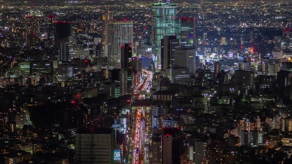 Timelapse Tokyo Street Highway with Heavy Traffic at Night