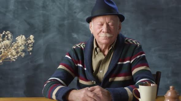 Thumbnail for Stylish Elderly Man Posing for Camera