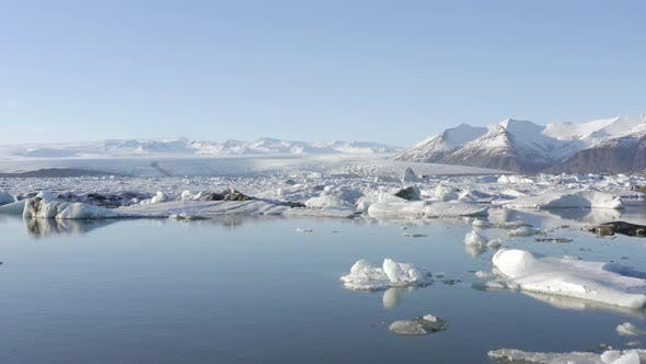 Thumbnail for Glacier Lagoon in Iceland Filled With Icebergs Low Flight