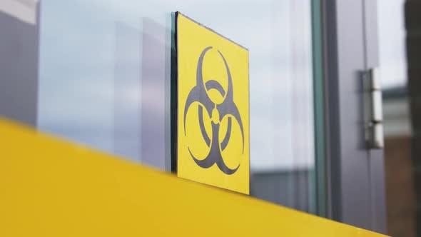 Yellow Biohazard Sign on Door