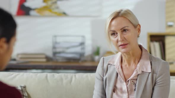 Thumbnail for Middle Aged Woman Speaking with Psychologist