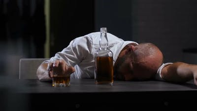 Alcoholic Wasted Man Sleeping Drunk on the Table