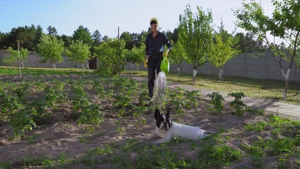 Thumbnail for Female in Uniform Gardening on Sunny Day