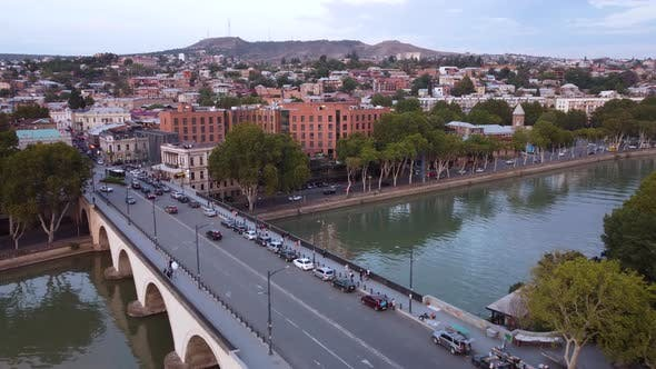 Traffic On The Bridge And Evening City Aerial