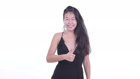 Thumbnail for Happy Beautiful Asian Woman Giving Thumbs Up