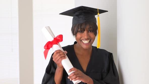 Excited black woman graduate