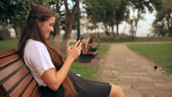 Thumbnail for Profile Happy Woman Messaging Outdoors
