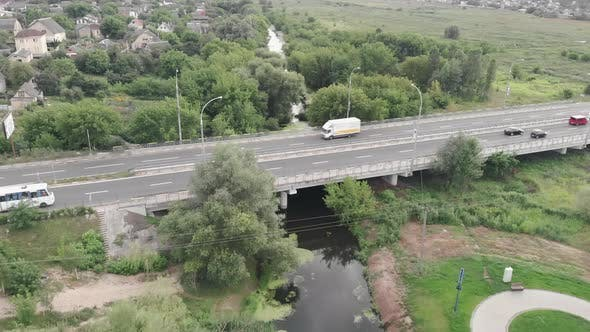 High speed motorway from bird's eye view. Drone view of highway road with cars and buses