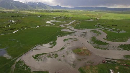River over flowing through landscape in Star Valley Wyoming