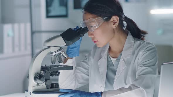 Thumbnail for Woman Testing Sample In Lab