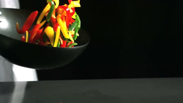 Thumbnail for Chef tossing wok of peppers