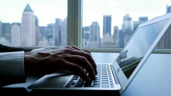 Thumbnail for Corporate Businessman Using Digital Laptop In Modern City Office