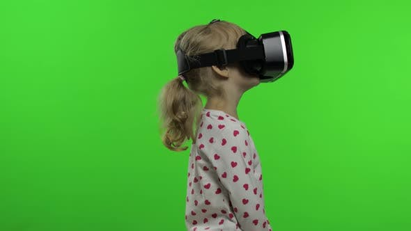 Cover Image for Child Girl Using VR Headset Helmet To Play Game. Watching Virtual Reality 3d 360 Video. Chroma Key