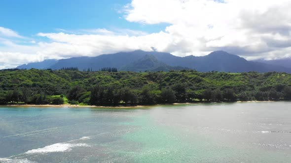 Thumbnail for Slow Aerial With Water At Anini Beach Kauai Hawaii Opening To Mountains