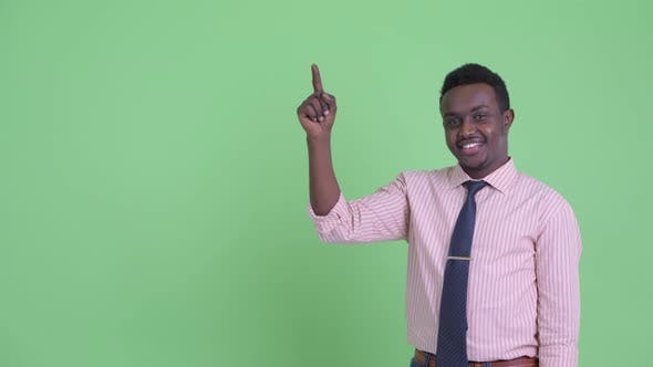Thumbnail for Happy Young African Businessman Pointing Up