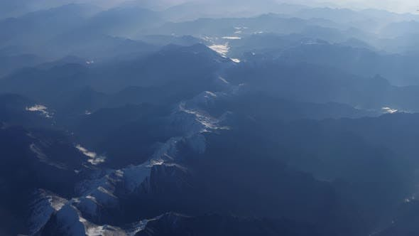 Cover Image for Beautiful View Through Airplane Window, Airplane Flying Above River in Mountains