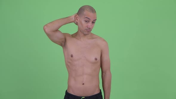 Thumbnail for Confused Bald Multi Ethnic Shirtless Man Scratching Head