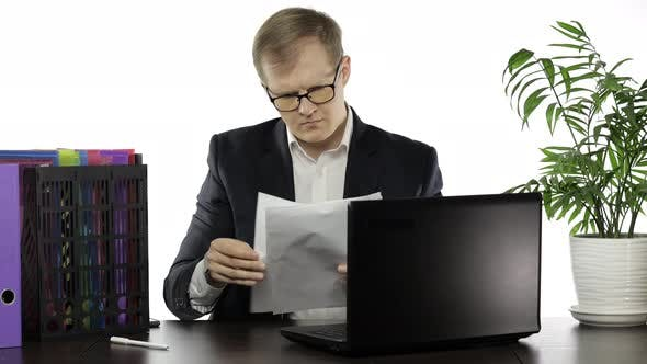 Thumbnail for Businessman Working in Office. Negative Amazed of Reading Paper Full of Mistakes