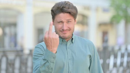 Aggressive Man showing Middle Finger